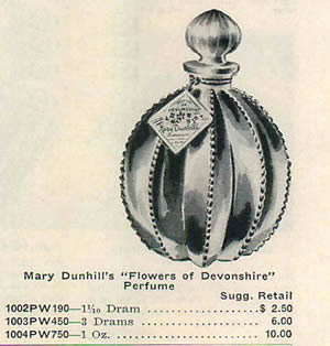 Flowers of Devonshire Perfume Bottle By Mary Dunhill 1958 Advertisement Showing one of the 2 Close Copy Bottles of both the original R. Lalique Gregoire Perfume Bottle and the Original R. Lalique Flowers of Devonshire Perfume Bottle for Mary Dunhill