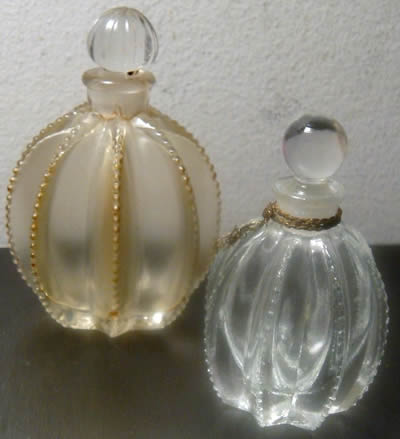 Flowers of Devonshire Perfume Bottles By Mary Dunhill That Are Close Copies of The R. Lalique Gregoire Perfume Bottle and also Close Copies of the Original R. Lalique Flowers of Devonshire Perfume Bottle that Lalique made for Mary Dunhill