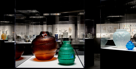 Rene Lalique Enchanted By Glass Exhibition At The Corning Museum View Inside The Exhbition Showing Amber Serpent and Green Ferriers Vases In Foreground
